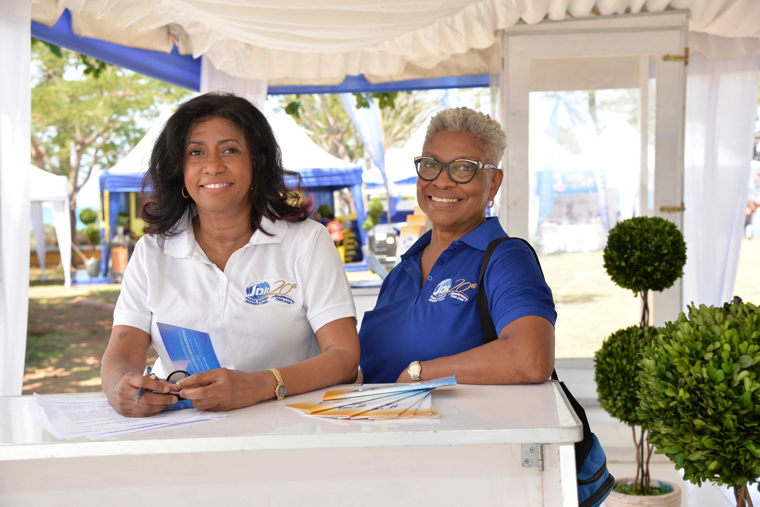 Chief Executive Officer., Antoinette McKain and Marjorie McGrath, Manager Corporate Communications smiled for the lens while awaiting the start of the JDIC's Public Forum and Financial Fair.