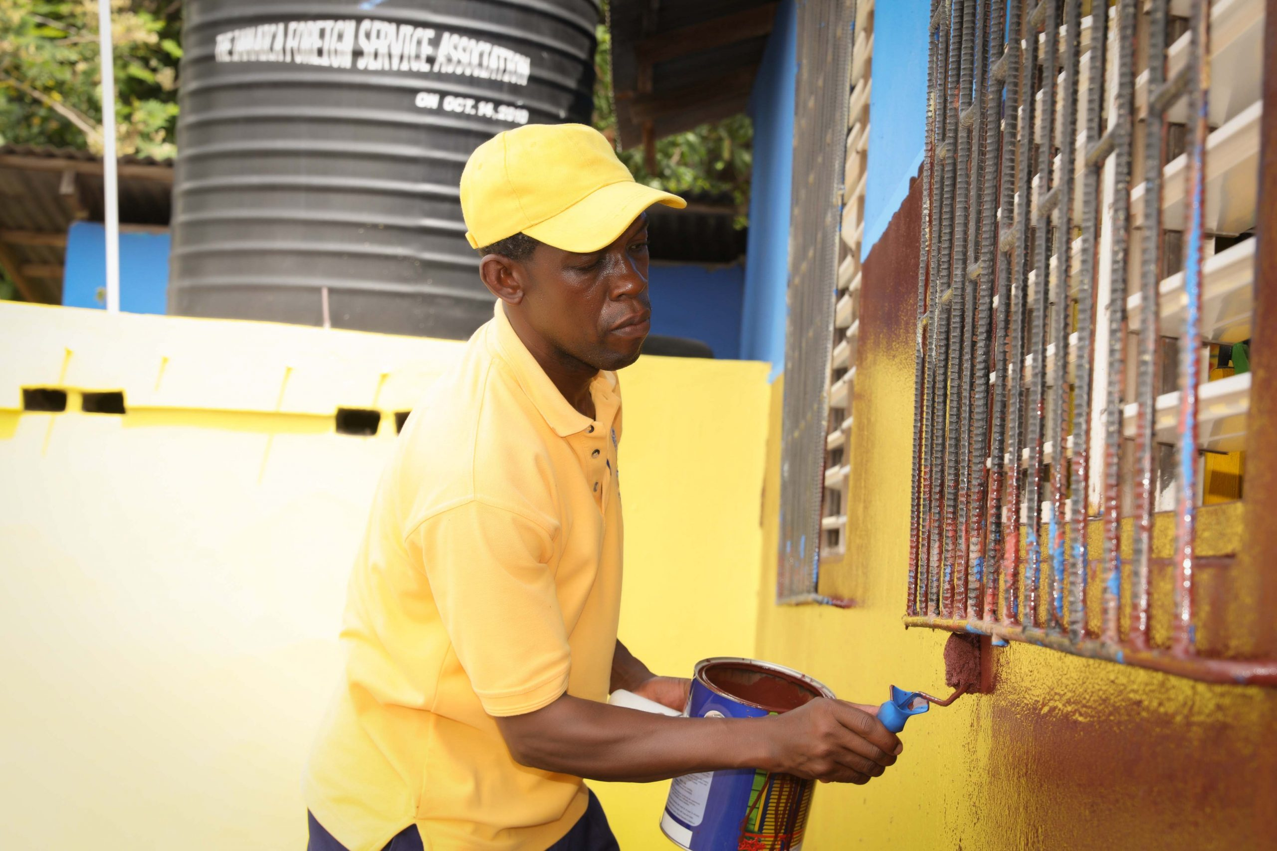 JDIC team members assisted by members of the Highlight View Community in Eastern St. Andrew sought to beautify the McLeod Basic School for Labour Day 2019.