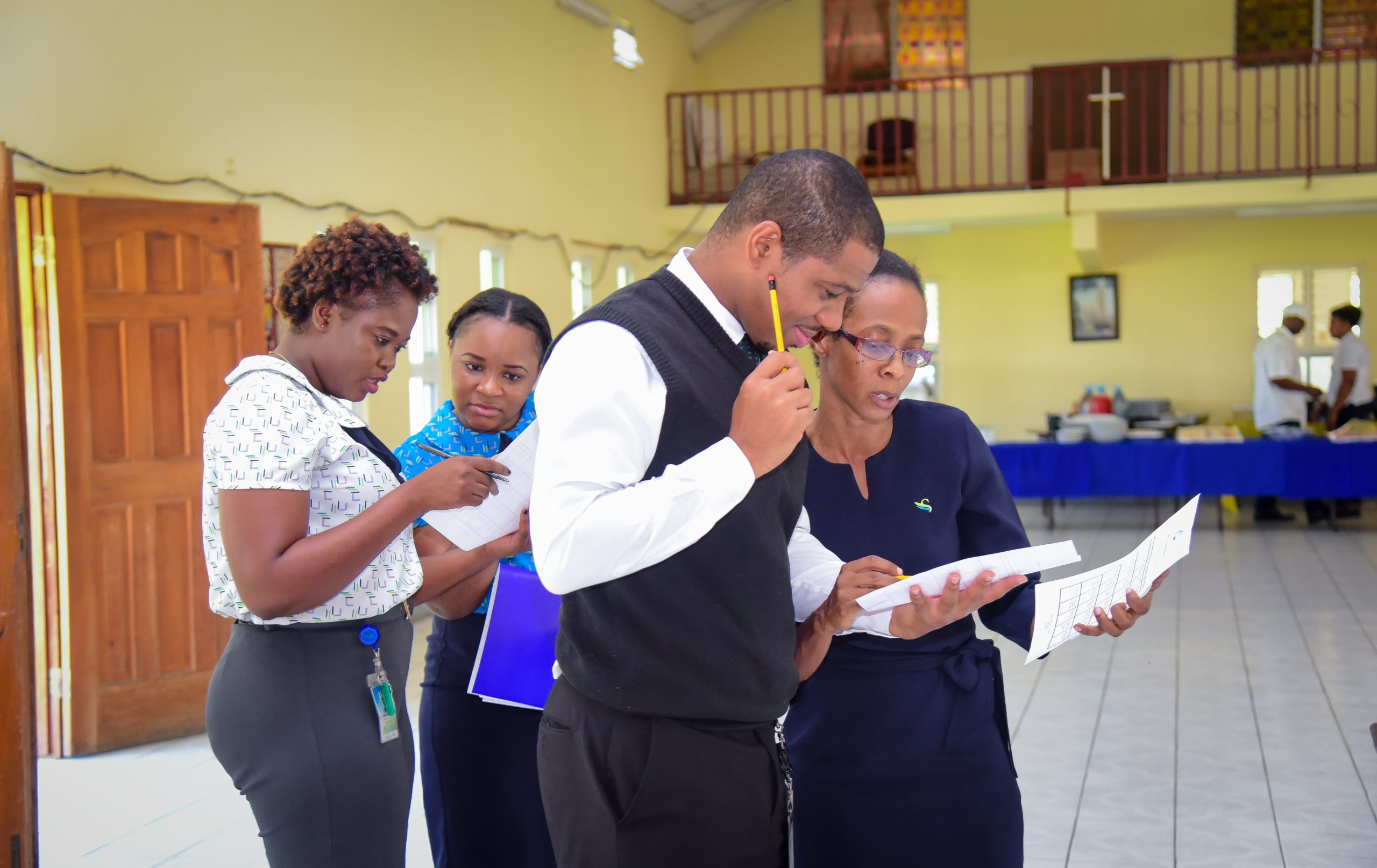 Policyholder staff from Western Jamaica engaged in discussion during a training session on the Deposit Insurance Scheme
